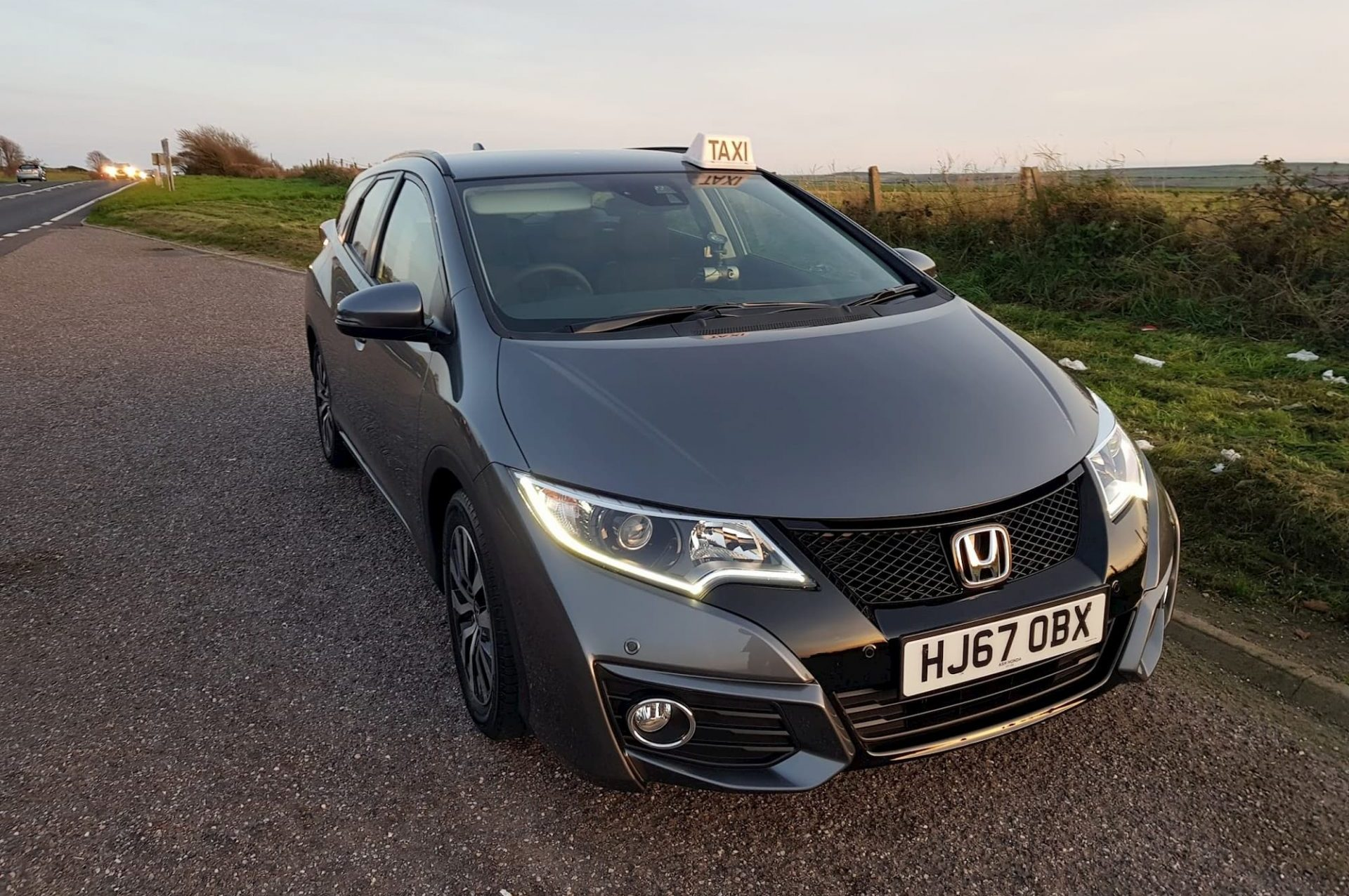 Dorset taxis Honda on countryside background